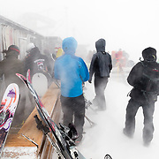 Skiers wait for the the mountain to open at the top of Corbet's Cabin on Rendevous Mountain at Jackson Hole Mountain Resort in Teton Village, Wyoming.