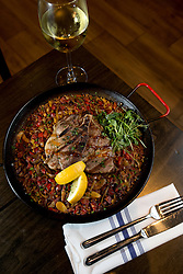 Paella tres cerditos (paella with pig three ways) at La Marchas Tapas Bar, Wednesday, Jan. 13, 2016, in Berkeley, Calif. (Photo by D. Ross Cameron)