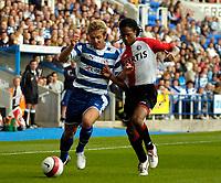 Photo: Ed Godden.<br />Reading v Feyenoord. Pre Season Friendly. 12/08/2006. Kevin Doyle (L) holds off Feyenoord's Serginho Greene.