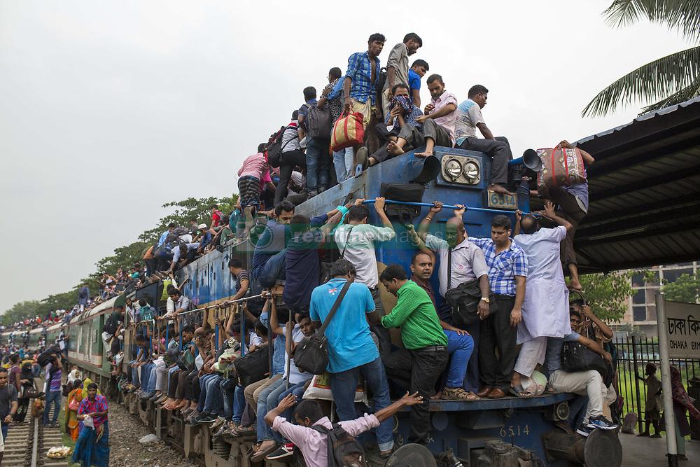 June 14, 2018 - Dhaka, Bangladesh - Bangladeshis cram onto a train as they travel back home to be with their families ahead of the Muslim festival of Eid al-Fitr in Dhaka , Bangladesh on June 14, 2018..Millions of city dwellers return home for Eid al-Fitr. (Credit Image: © Zakir Hossain Chowdhury via ZUMA Wire)
