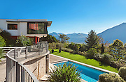 Modern villa with pool, view from the passage