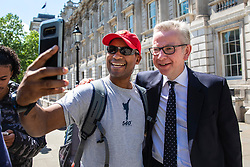 © Licensed to London News Pictures. 21/05/2019. London, UK. Secretary of State for Environment, Food and Rural Affairs Michael Gove poses for a selfie with a member of the public as he leaves after the Cabinet meeting. Prime Minister Theresa May is expected to make a statement to Paliament outlining changes to the Withdrawal Agreement Bill before it is brought back before Parliament. Photo credit: Rob Pinney/LNP
