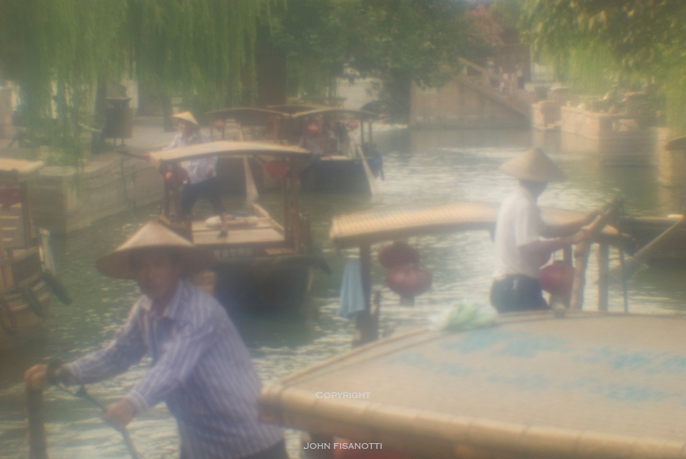 Boaters on the Canals of Zhujiajiao, China