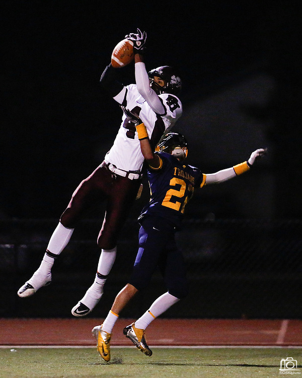 Piedmont Hills' wide receiver Isaiah Stewart (4) battles Milpitas' defensive back Victor Rodriguez (22) in the end zone during the CCS Division 1 playoff game at Milpitas High School in Milpitas, California, on November 29, 2013.  The pass intended for Rodriguez was not complete.  No. 2 Milpitas beat No. 3 Piedmont Hills 45-0. (Stan Olszewski/SOSKIphoto)