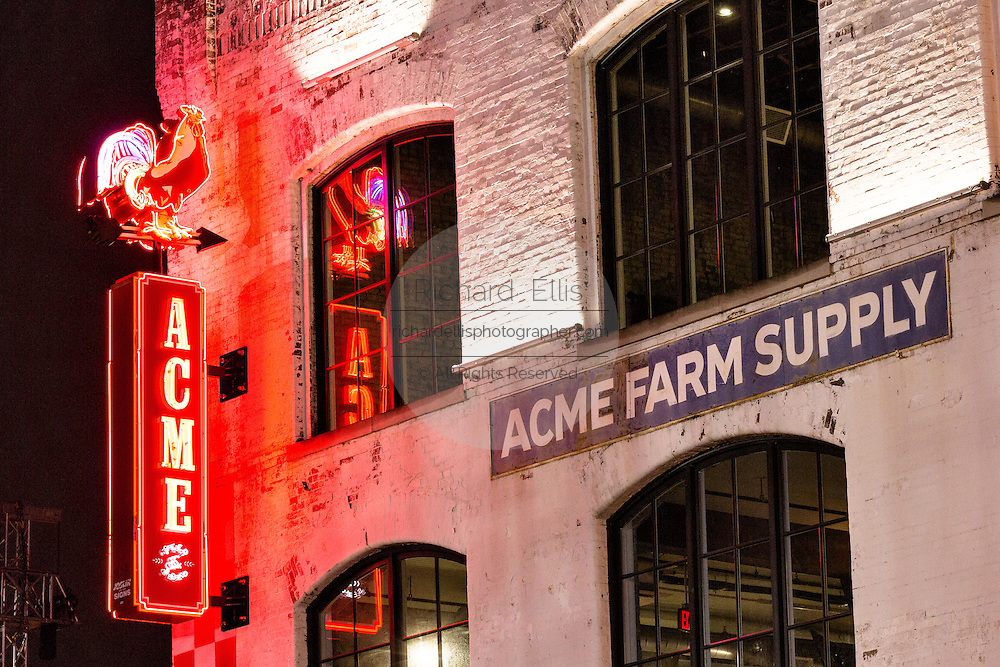 Neon sign for Acme Farm Supply restaurant on lower Broadway in Nashville, TN.
