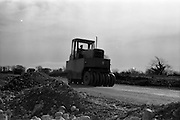 07/03/1963<br /> 03/07/1963<br /> 07 March 1963<br /> Greens Pneumatic Roller in action on roadworks beyond HorseLeap, Co. Offaly. Special for Kenny's Advertising.