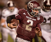 Nov 9, 2013; College Station, TX, USA; Texas A&M Aggies quarterback Johnny Manziel (2) scrambles against the Mississippi State Bulldogs during the second half at Kyle Field. Texas A&M won 51-41. Mandatory Credit: Thomas Campbell-USA TODAY Sports