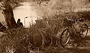 Israel, Tel Aviv, Yarkon River. Sepia, retro style image with bicycle