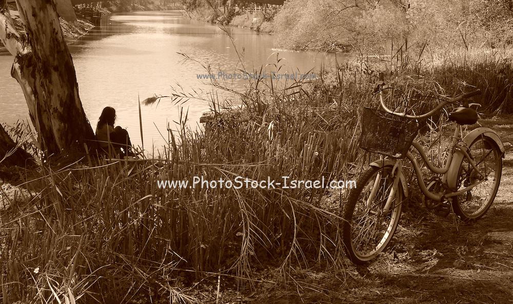 Israel, Tel Aviv, Yarkon River. Sepia, retro style image with bicycle