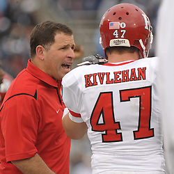 Oct 31, 2009; East Hartford, CT, USA; Rutgers head coach Greg Schiano speaks with cornerback Patrick Kivlehan (47) after Kivlehan missed a coverage during second half Big East NCAA football action in Rutgers' 28-24 victory over Connecticut at Rentschler Field.
