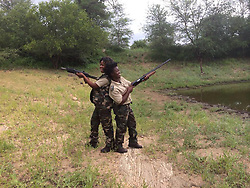 July 7, 2015 - BALULE RESERVE, SOUTH AFRICA: Black Mamba recruits training in the bush. LED BY BRITISH former military personnel these pictures show how courageous women anti-poachers train with guns in their battle to preserve Africa's endangered animals. Operating in the Kruger National Park's Balule Nature Reserve the 24-member strong all-female Black Mamba Anti-Poaching Unit patrols 50,000 hectares of bush to protect elephants and rhinos that are hunted as part of the estimated £12billion a year illegal world animal trade. These ladies, who as pictures show pose with weapons but also know how to party, are on the front line of a deadly war for the resources of their continent. Over the past year 1,000 wildlife rangers have been killed in Africa while protecting endangered wildlife. Black Mamba Commander and former Royal Navy serviceman Russell Baker (28) from Grimsby, UK explained exclusively how and why this South African special unit was established. (Credit Image: © Media Drum World/MediaDrumWorld/ZUMAPRESS.com)