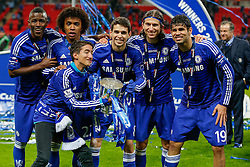Jose Mourinho Jr (son of the Chelsea Manager) poses with Ramires, Willian, Oscar, Filipe Luis and Diego Costa after Chelsea win the Capital One Cup Final - Photo mandatory by-line: Rogan Thomson/JMP - 07966 386802 - 01/03/2015 - SPORT - FOOTBALL - London, England - Wembley Stadium - Chelsea v Tottenham Hotspur - Capital One Cup Final.