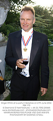 Singer STING at a party in Berkshire on 27th June 2002.PBK 173