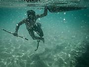 Dido fishing for coral fish and shells off Mantabuan island.