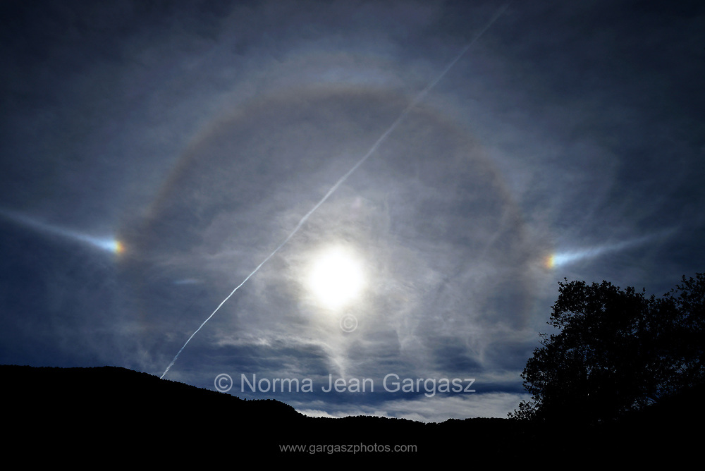 Sun Dogs and a contrail are seen from the Arizona Trail in the Santa Rita Mountains, north of Patagonia, Arizona, USA.
