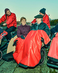 Pictured: Nicola Sturgeon joins Cycling Without Age user Cyril Corcoran from Galashiels trying out the specially designed bicycle rickshaws.  <br /> <br /> SNP leader Nicola Sturgeon campaigns in Hawick in the Scottish Borders.<br /> <br /> © Dave Johnston / EEm