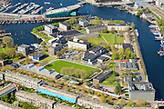 Nederland, Noord-Holland, Amsterdam, 09-04-2014;<br /> Marineterrein en Kattenburg (links), bovenin Scheepvaartmuseum , de IJtunnel en museum Nemo met historische woonboten. <br /> Beneden de Dijksgracht en het spoor.<br /> Navy area and the National Maritime Museum (white building), right Museum Nemo.<br /> luchtfoto (toeslag op standard tarieven);<br /> aerial photo (additional fee required);<br /> copyright foto/photo Siebe Swart