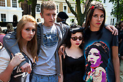 "Brandon Hayward (far right 16) a loyal and deeply upset and distressed Amy Winehouse fan poses with his friends at the memorial opposite the home of Amy Winehouse, Camden Square, North London. In signature make up and wearing a t-shirt of her image, he said ""It's destroyed me. It's killed me. We hadn't seen too much of her in the press recently so thought things were alright, and now this, she's died. I don't know what to do, how I can make it better."" Brandon had first seen Winehouse at his first ever gig just aged 12 years old. It was announced that the tragic singer had died on 23rd July 2011. The music world has been paying tribute to singer Amy Winehouse, 27, who was found dead at her London home following years of drug and alcohol abuse largely attributed to her troubled character and fame."