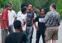 American herpetologist Hinrich Kaiser talks with a group of Timorese men in the Liquica district of Timor-Leste (East Timor).