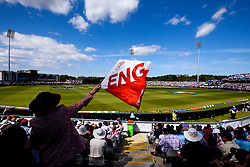 An England fan waves a flag at The Emirates Riverside stadium during England v New Zealand - Mandatory by-line: Robbie Stephenson/JMP - 03/07/2019 - CRICKET - Emirates Riverside - Chester-le-Street, England - England v New Zealand - ICC Cricket World Cup 2019 - Group Stage