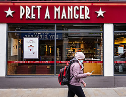 © Licensed to London News Pictures. 18/03/2020. London, UK. A women in a medical mask walks past a Pret A Manger in Westminster, which has closed early due to low customer demand as the majority of workers keep away from the centre of London as Coronavirus pandemic crisis continues. Photo credit: Alex Lentati/LNP