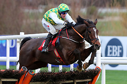 The Church Gate ridden by Robbie Power jumps the last before going to win the Irish Daily Star Christmas Handicap Hurdle during day three of the Leopardstown Christmas Festival at Leopardstown Racecourse.
