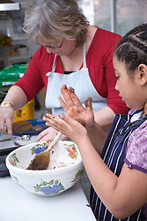 Woman and little girl making some biscuits,