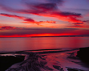 Glorious red sunset over Lake Superior, Lake Superior Provincial Park, Ontario, Canada.