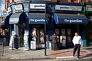 Newsagents heavily sponsored by The Guardian Newspaper on the corne of Grays Inn Road and Clerkenwell Road, London.