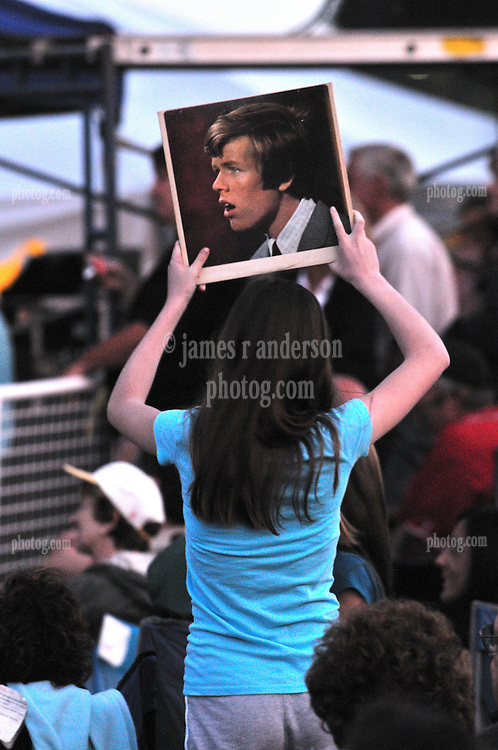 Female Fan holding Herman's Hermits album cover over her head at Herman's Hermits Concert starring Peter Noone, in performance at the Hamden Free Summer Concert Series, July 2009