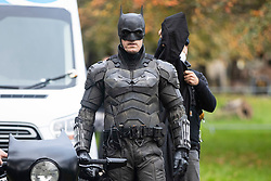 © Licensed to London News Pictures. 13/10/2020. Liverpool, UK. A Batman stunt double films a scene at Anfield Cemetery, Liverpool for The Batman movie. Photo credit: Kerry Elsworth/LNP