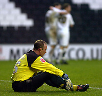 Photo: Matt Bright/Sportsbeat Images.<br />Milton Keynes Dons v Accrington Stanley. Coca Cola League 2. 08/12/2007.<br />Ian Dunbavin of Acrington cosiders life between the posts as Colin Cameron and Keith Andrews of MK Dons celebrate