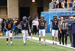 Sep 8, 2018; Morgantown, WV, USA; West Virginia Mountaineers captains walk onto the field prior to their game against the Youngstown State Penguins at Mountaineer Field at Milan Puskar Stadium. Mandatory Credit: Ben Queen-USA TODAY Sports