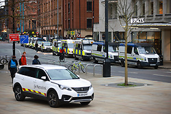 """© Licensed to London News Pictures. 27/03/2021. Manchester, UK. Several police vans arrive as protesters block trams in St Peter's Square . Hundreds at """" Kill the Bill """" and Reclaim the Streets demonstrations in Manchester City Centre, in opposition to the Police, Crime, Sentencing and Courts Bill 2021 that is currently before Parliament and after the death of Sarah Everard in London . Photo credit: Joel Goodman/LNP"""