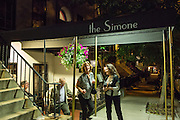 New York, NY - 27 May 2014. New York, NY - 27 May 2014. The entrance to The Simone, at 151 East 82d Street, on Manhattan's Upper East Side. Diners bid adieus to General Manager Tina Vaughn.