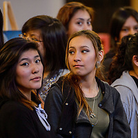 Finalist Keyera Tsosie, center, stands with a group of her fellow artists during the Brea Foley Portrait Competition at the Navajo Nation Museum in Window Rock Friday.