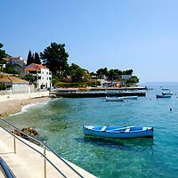 Empty seafront with blue boat;<br />Bol, Brac, Croatia.