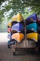 canoes stacked on a trailer, tied down and ready to be put into a whitewater river.along the Pig Trail in the Ozark Mountains of Arkansas