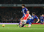 Arsenal's Jack Wilshere gets caught late by Manchester United's Paddy McNair and goes off injured<br /> <br /> Barclays Premier League- Arsenal vs Manchester United - Emirates Stadium - England - 22nd November 2014 - Picture David Klein/Sportimage