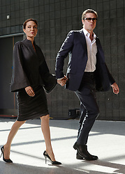 Angelina Jolie and Brad Pitt arrive at the End Sexual Violence in Conflict Summit at the Excel centre, in London.