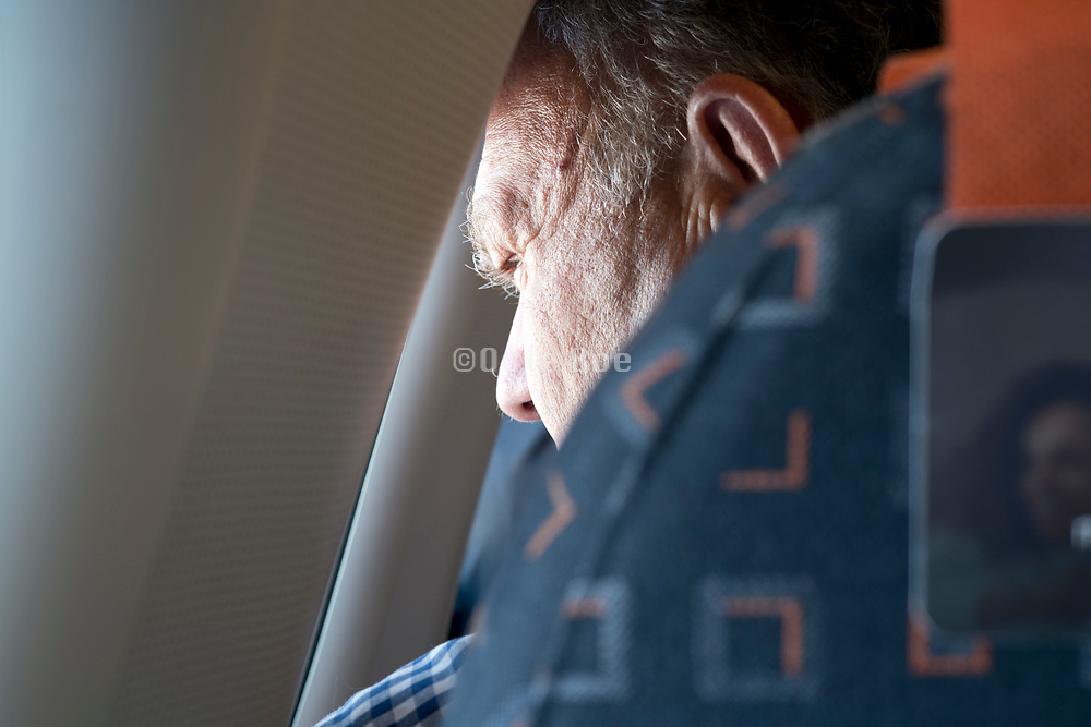 looking out of the window of a commercial passenger airplane