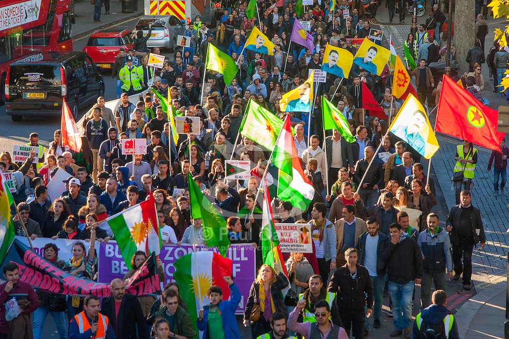 London, October 11th 2014. Thousands of protesters from the UK's Kurdish community demonstrate in London against the delay in assisting the people of the Syrian city of Kobane in their fight against ISIS. They also accuse Turkey, with whom the Kurds have had a long-running insurgency of siding with the Islamic State by doing nothing to help Kurds in Kobane. PICTURED: Thousands of British Kurds march along Northumberland Avenue in Westminster