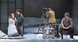 © Licensed to London News Pictures. 06/09/2012. Welsh National Opera present Puccini's La Boheme at the Wales Millennium Centre, Cardiff. Picture shows: Giselle Allen as Mimi, Alex Vicens as Rodolfo, David Kempster as Marcello. Photo credit : Tony Nandi/LNP