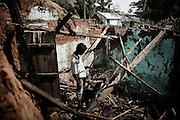 Indian Christian man returns to his house damaged during rioting by hardline Hindu activists in Orissa's Kandhamal district, some 350 kms southwest of Bhubaneswar. Nov. 6, 2008. .