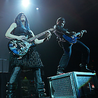 ST. PAUL, MN - MARCH 26: Skillet rhythm guitar and keyboardist Amy Cooper (L) and Jonathan Salas(R) perform during the 2011 Avalanche Tour at the Roy Wilkins Auditorium on Saturday, March 26, 2011 in St. Paul, Minnesota.  (Photo by Adam Bettcher/Getty Images) *** Local Caption *** Amy Cooper, Jonathan Salas