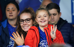 A young fan in the stands shows their support prior to the FA Women's Super League match at Kingsmeadow, London. Picture date: Saturday October 2, 2021.