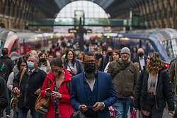 © Licensed to London News Pictures. 21/10/2021. London, UK. Commuters arriving to King's Cross in central London this morning. Health Secretary Sajid Javid warned Covid 19 cases could reach 100,000 a day this winter and urged people to take precautions against the virus. Photo credit: Marcin Nowak/LNP