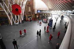 © Licensed to London News Pictures. 11/11/2020. London, UK. A two minute's silence is observed at Kings Cross station in London, to mark remembrance day. This years Armistice Day is taking place during a national lockdown, aimed at fighting the spread of Coronavirus COVID-19. Photo credit: Ben Cawthra/LNP