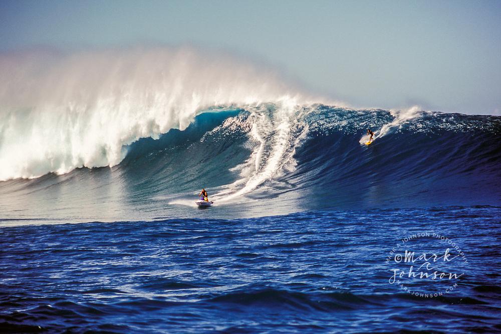 Tow-in Surfing a huge wave, Kauai, Hawaii