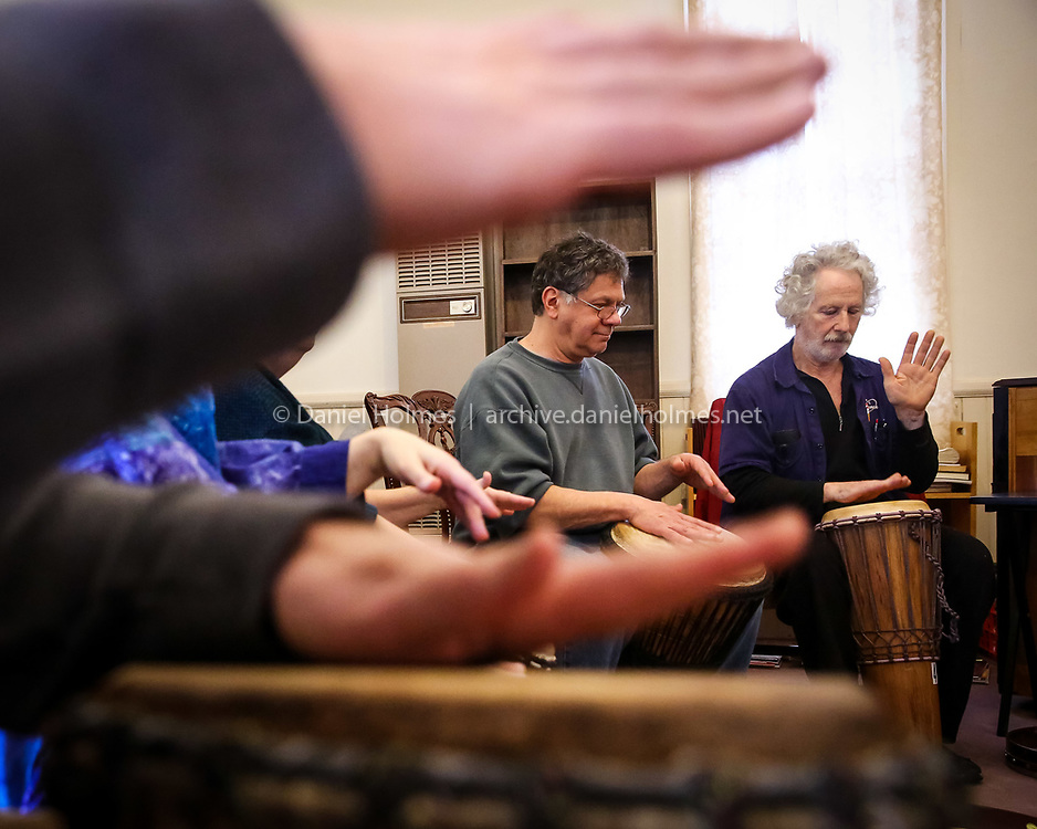 (3/30/14, HUDSON, MA) Hudson residents Paul Rogoshewski, left, and Jerenzo Fine drum during a one-hour workshop put on by Dave Curry at the Unitarian Church of Marlborough and Hudson in Hudson on Sunday. Daily News and Wicked Local Photo/Dan Holmes